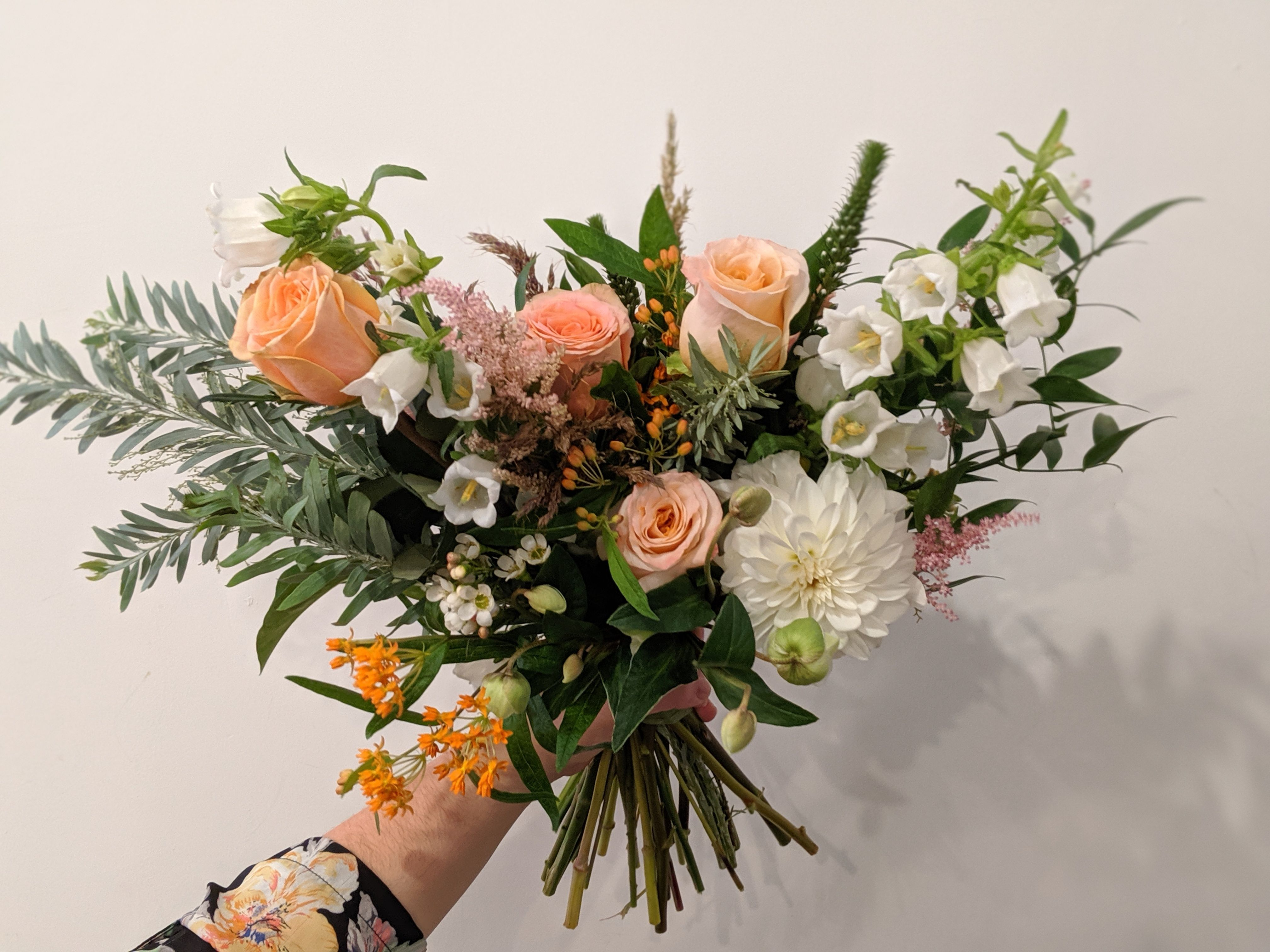 Whimsical peach and white summer bridal bouquet by Adore Floral