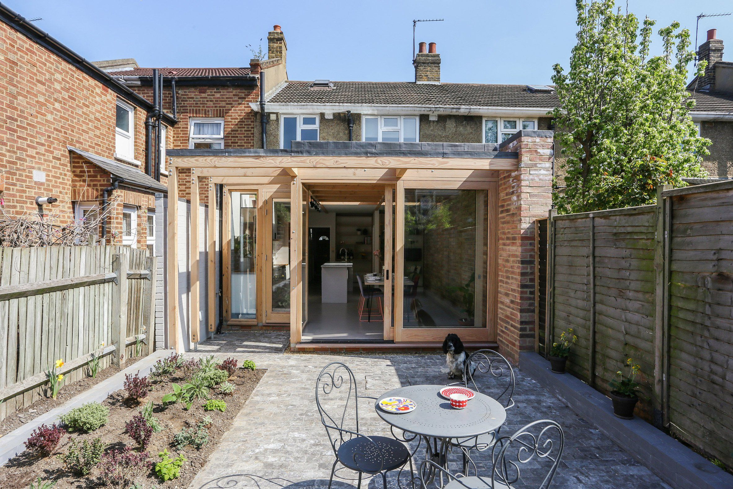 Nimtim adds pergola-like extension to 1950s terrace in south London ...