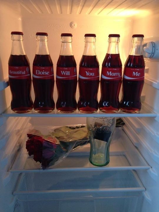 """Last week, Donnie McGilvray claimed he proposed to his girlfriend using Coca-Cola bottles, spelling out """"Beautiful"""" """"Eloise"""" """"Will"""" """"You"""" """"Marry"""" """"Me"""". He then shared this photo of it on the Coca-Cola Facebook page. 