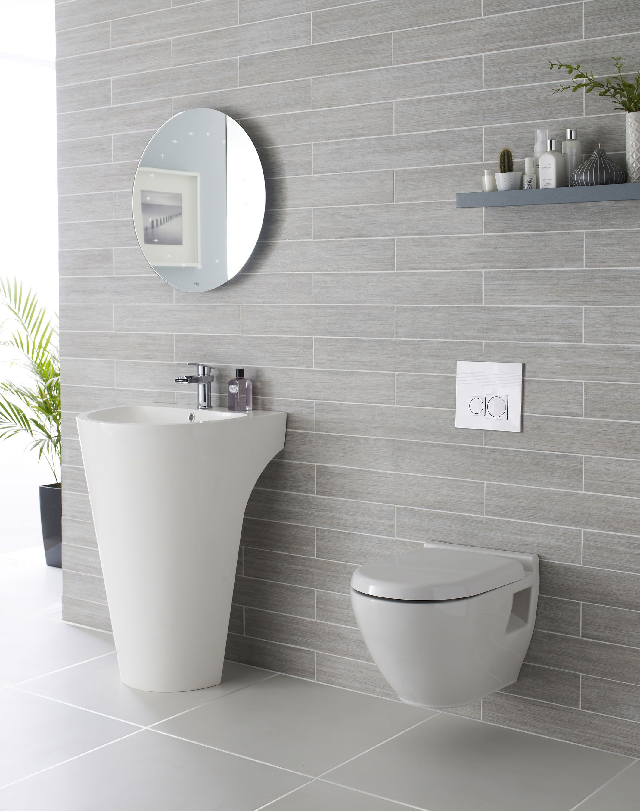 we adore this white and grey bathroom complete with lavish basin  - grey tile bathroom complete with lavish basin