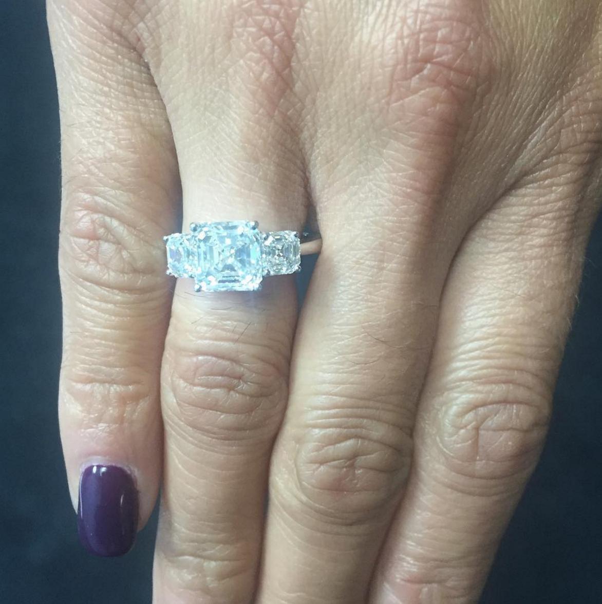 Three stone asscher cut engagement ring.