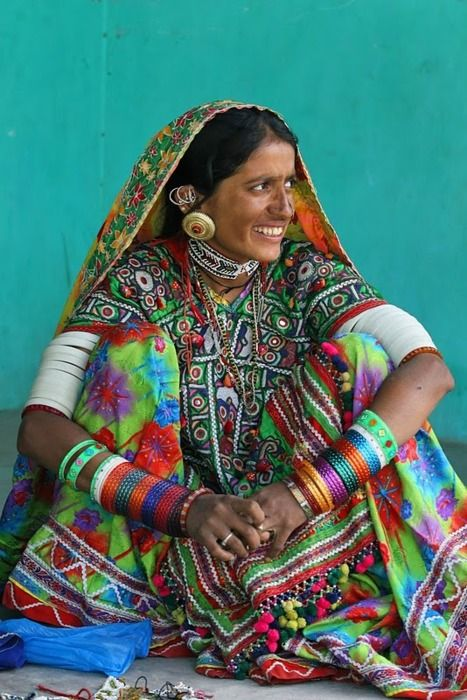 Gujarati Woman (India) - this is just amazing, she is wearing beautiful textiles and arms full of bangles