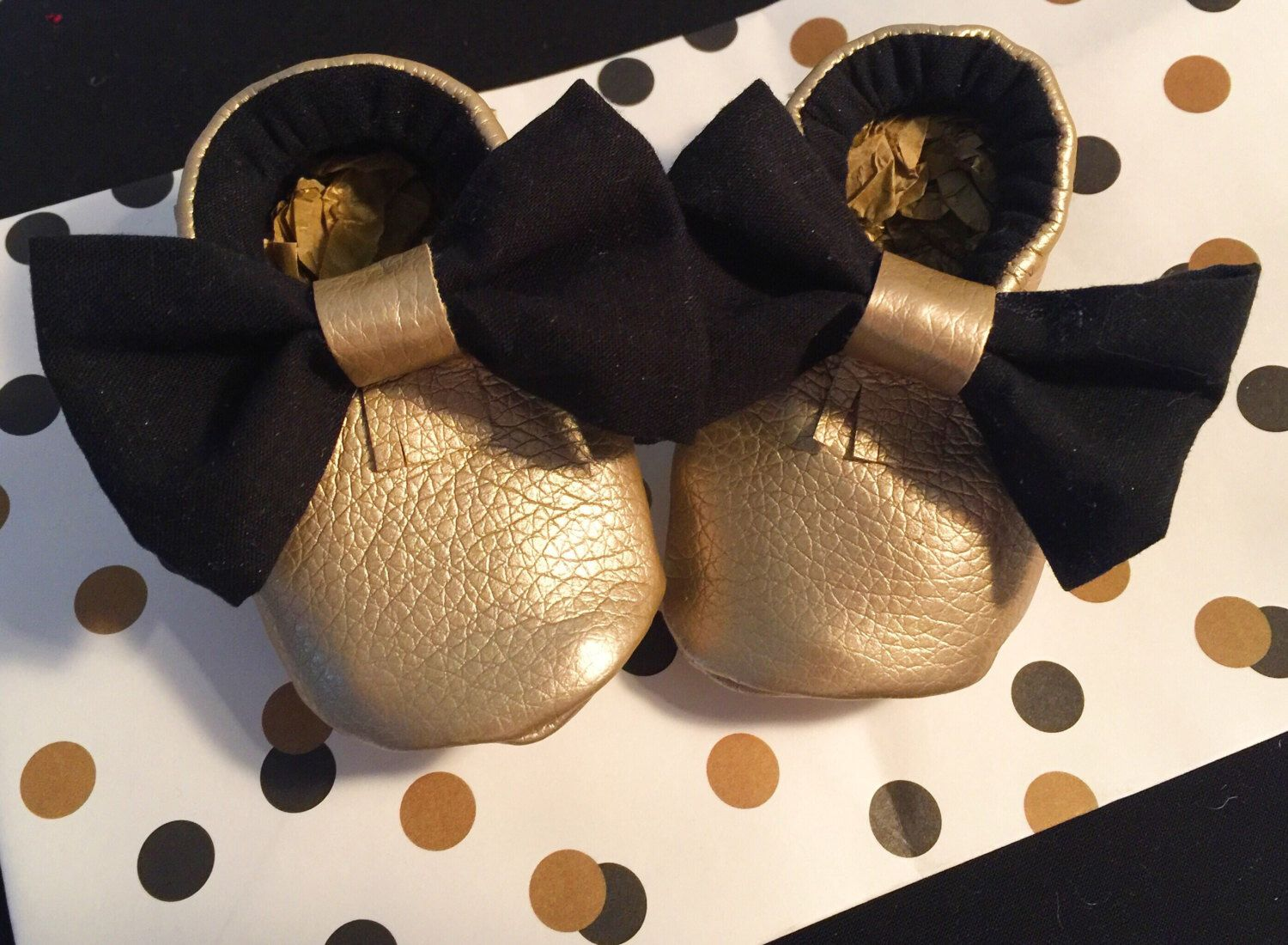Adorable Gold and Black baby Moccs by MamabirdMoccs on Etsy https://www.etsy.com/listing/264407350/penelope-moccs-gold-bow-moccasins-faux