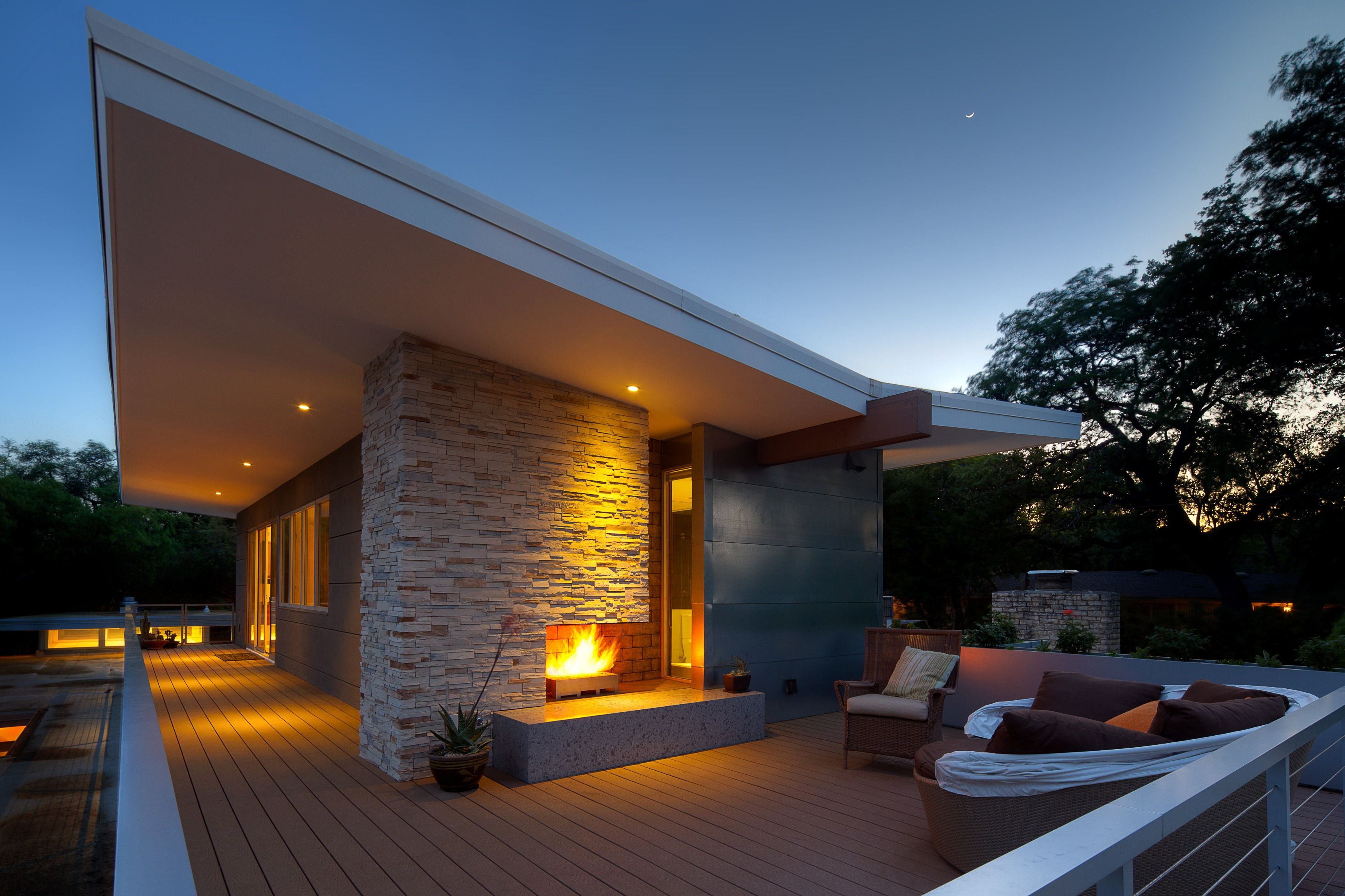 outdoor living outdoor fireplace concrete butterfly roof