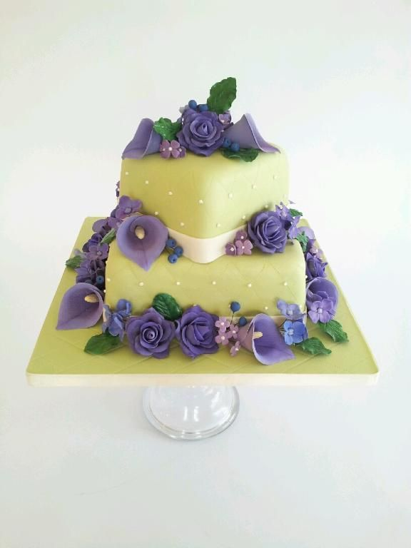 """Take a look at this elegant quilted floral cake by Craftsy member Schmulie14! Aren't the purple sugar flowers gorgeous? Click the image to get a closer look at this great project & click the heart to let the decorator know what you think! Click """"Repin"""" if you love cake decorating! #cakedecorating #sugarflowers"""