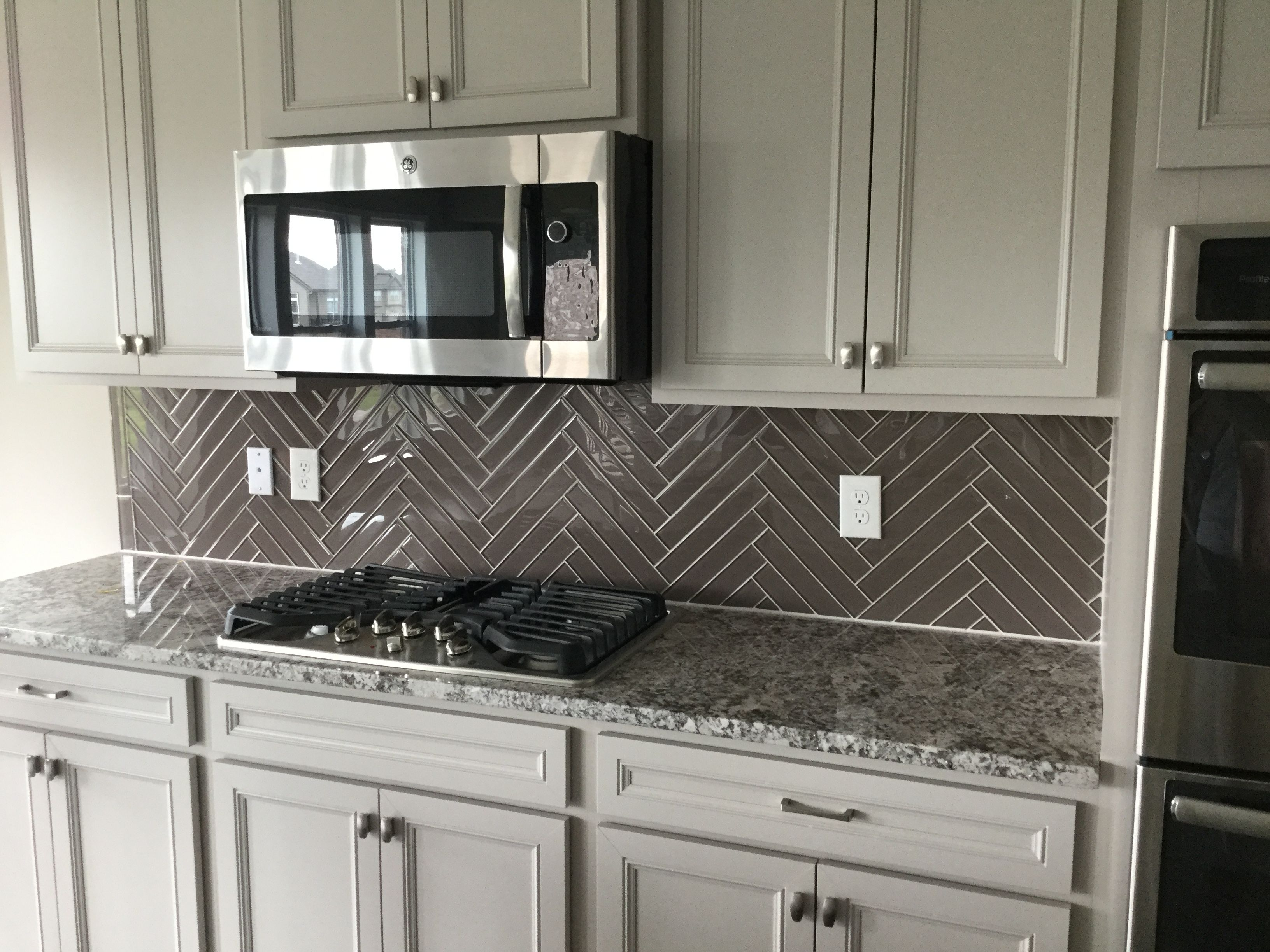2x12 glass tile in herringbone pattern