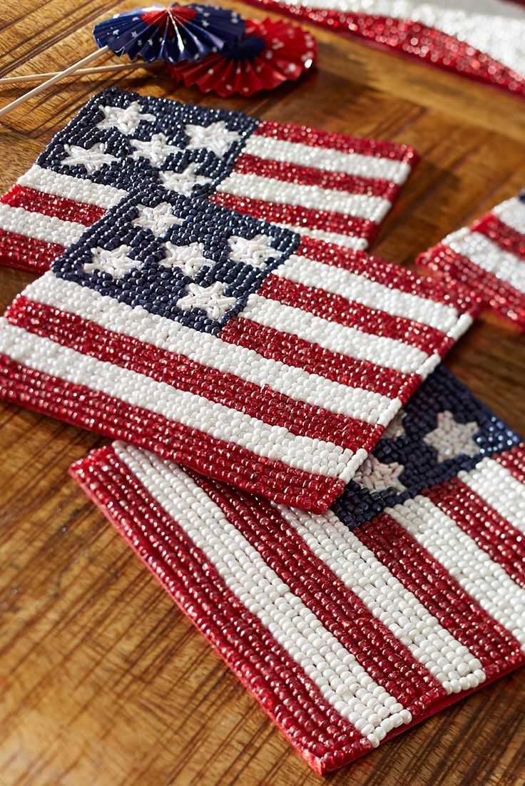 38c6482e6d87 Add some all-American sparkle to your Independence Day table with Pier 1 s American  Flag Beaded Coaster Set. Each one is handcrafted with glass beads in ...