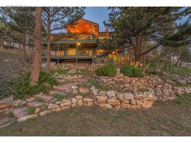 """Cory's #HOTPICK of the week is an """"inside/outside"""" designed home among evergreens and next to a lake! Plenty of opportunity to water ski, kayak, canoe, fish, bike and hike... The absolute best of nature and a gated community.  Click below to see more pictures...  (Listed by RE/MAX of Boulder, Inc)  #BringingYouColorado #TheWinningTeamRealEstateGroup #CoryDudley #ColoradoRealEstate #BoulderHomes #Homebuyers #MountainViews #Mountains #WaterSports"""