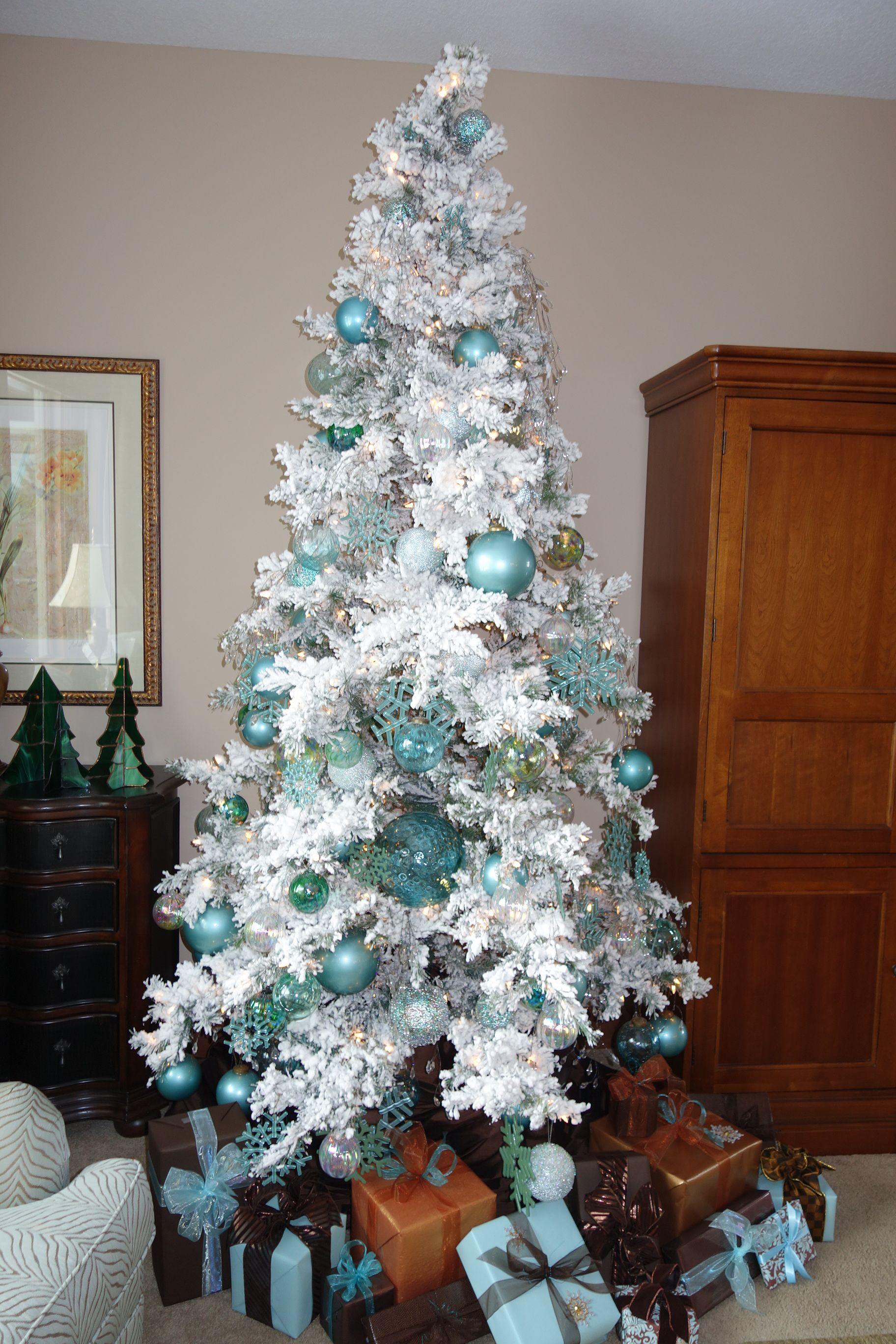 White Flocked Christmas Tree With Turquoise, Copper And Brown Wrapped