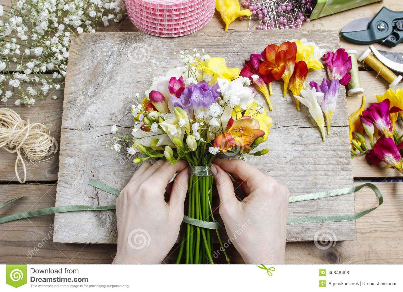 Florist work woman making bouquet freesia flowers house decoration florist work woman making bouquet freesia flowers house izmirmasajfo Gallery