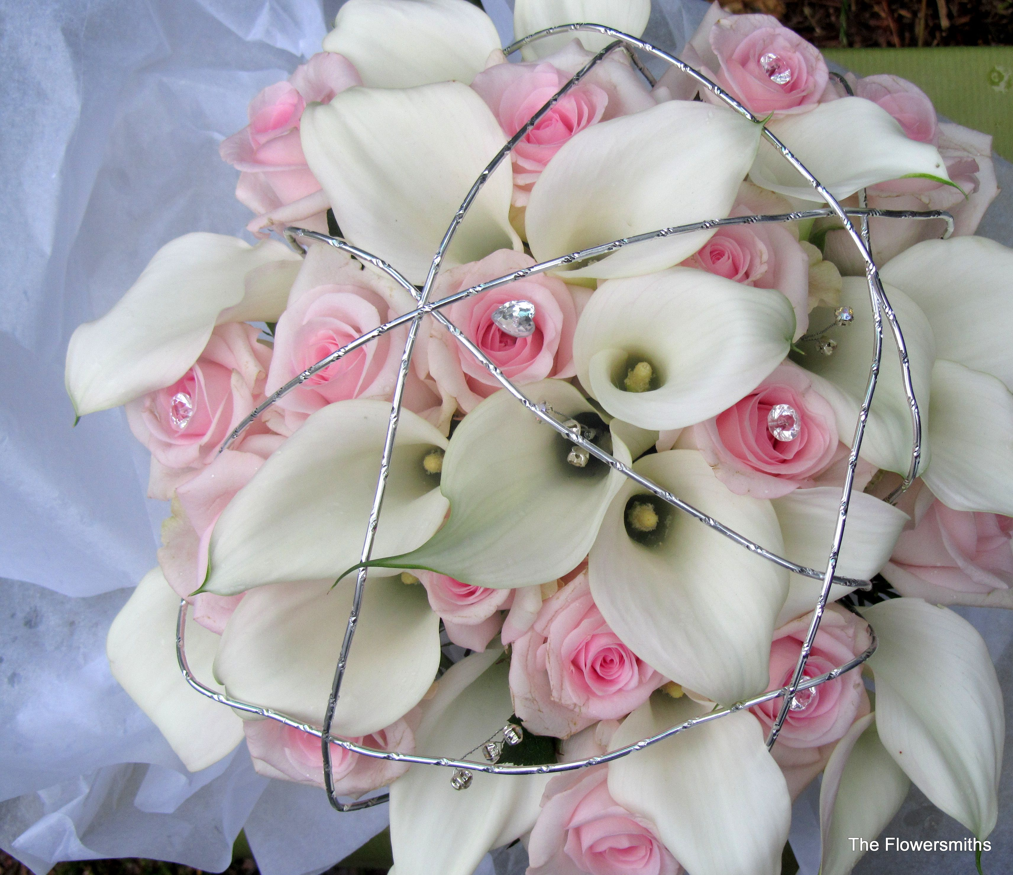 Wedding bouquet with calla lilies and pale pink roses. www
