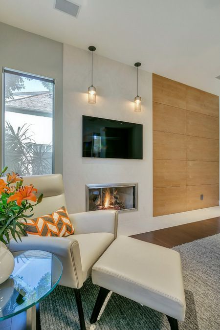 Wood Paneled Room Design: Modern Limestone Fireplace, Wood Paneled Walls