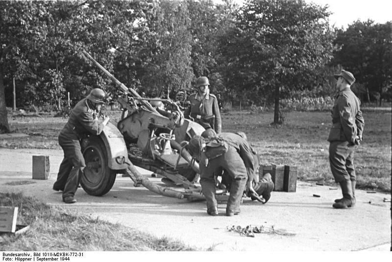 German crew prepares a 2 cm Flak 30 gun against british