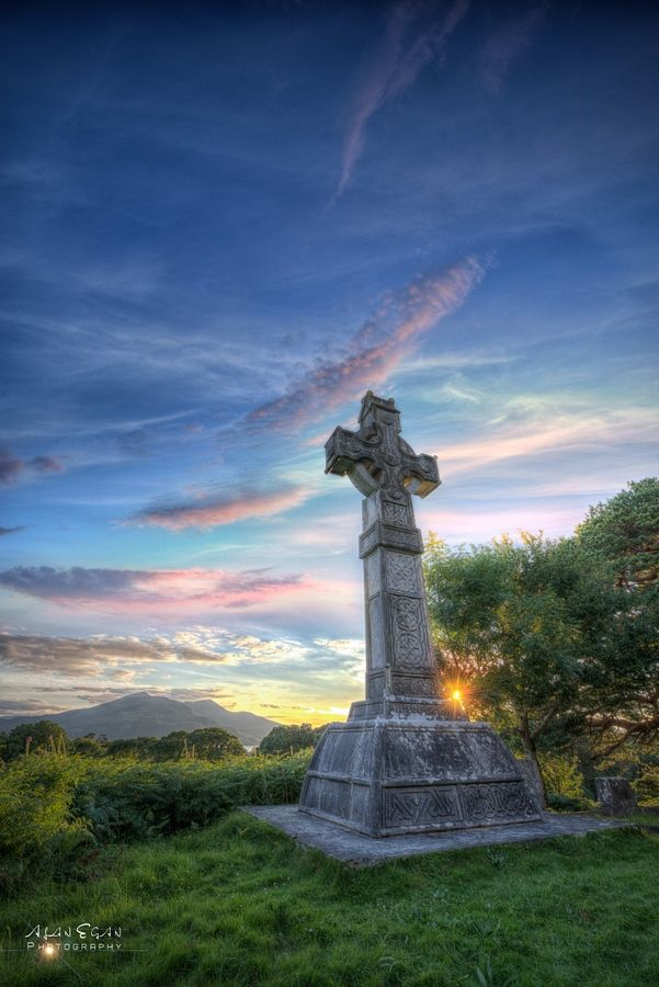 Celtic Cross overlooking the lakes of Killarney. The enormous cross stands about 15ft on a hill overlooking Muckross House Estate in Killegy cemetery.