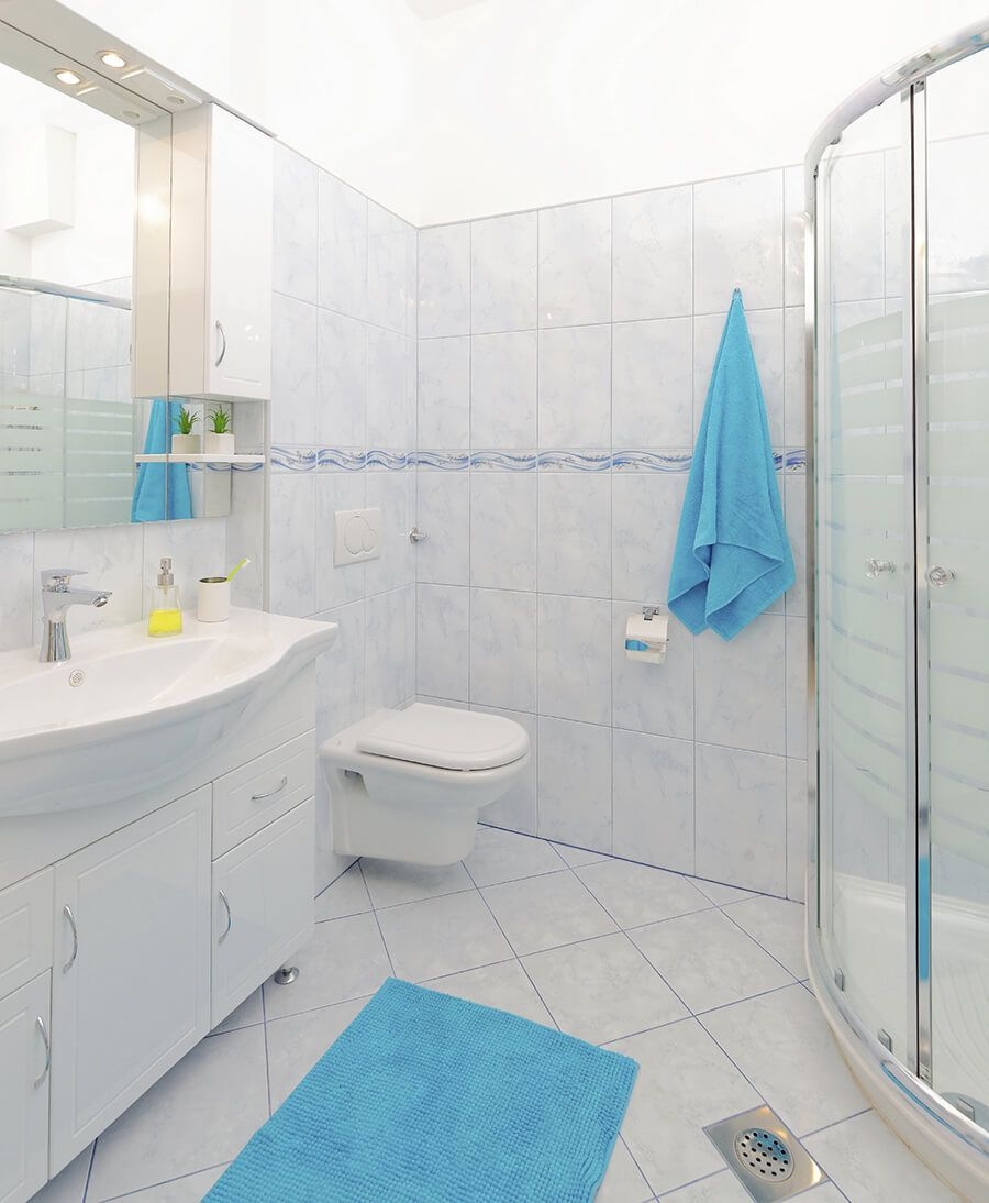 Traditional White Bathroom Idea With Light Blue Tiles | Bathroom ...