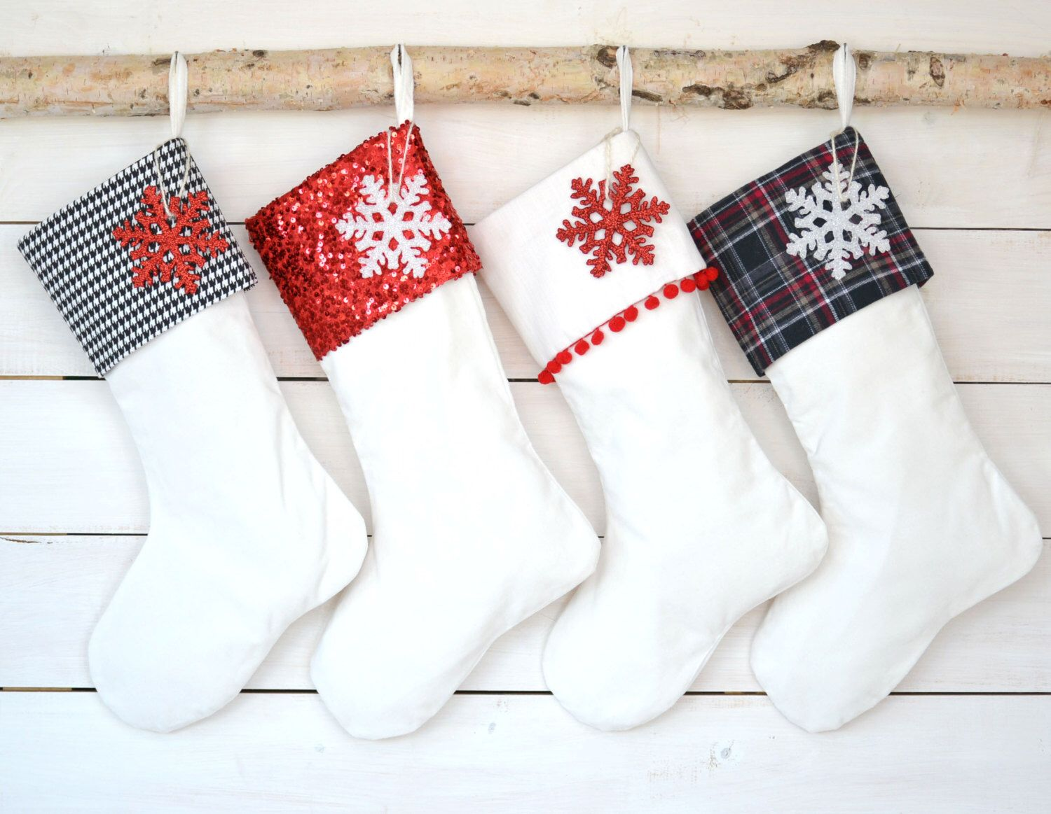 Hang ornaments with each of the stockings with each\'s name on it ...