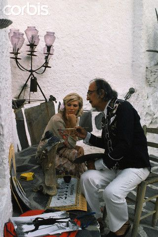 Spanish Catalan surrealist painter, sculptor, and screenwriter Salvador Dali with his muse, French singer Amanda Lear, at his home in Port Lligat.
