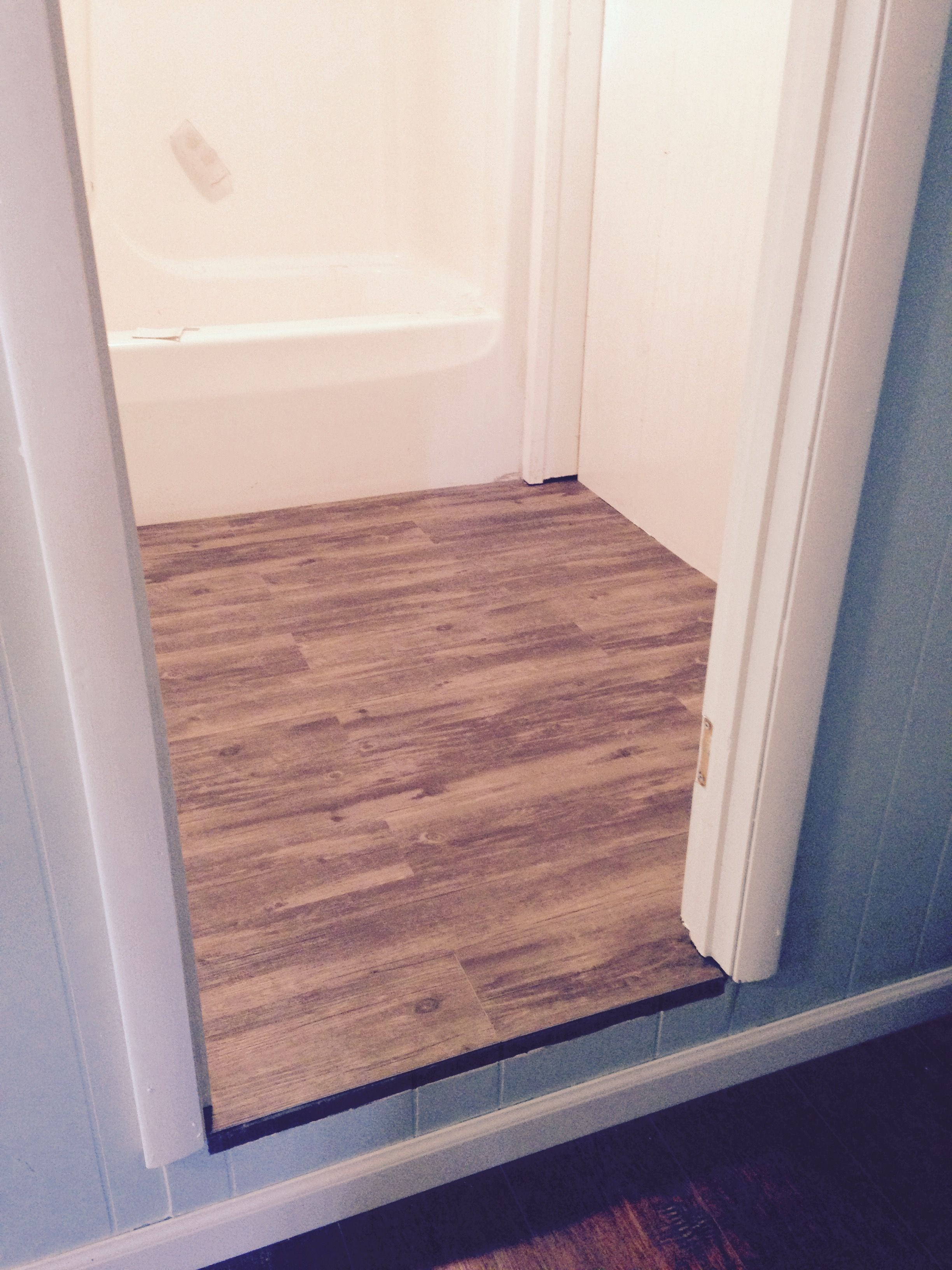 Dublin pine vinyl flooring on small bathroom remodel ...