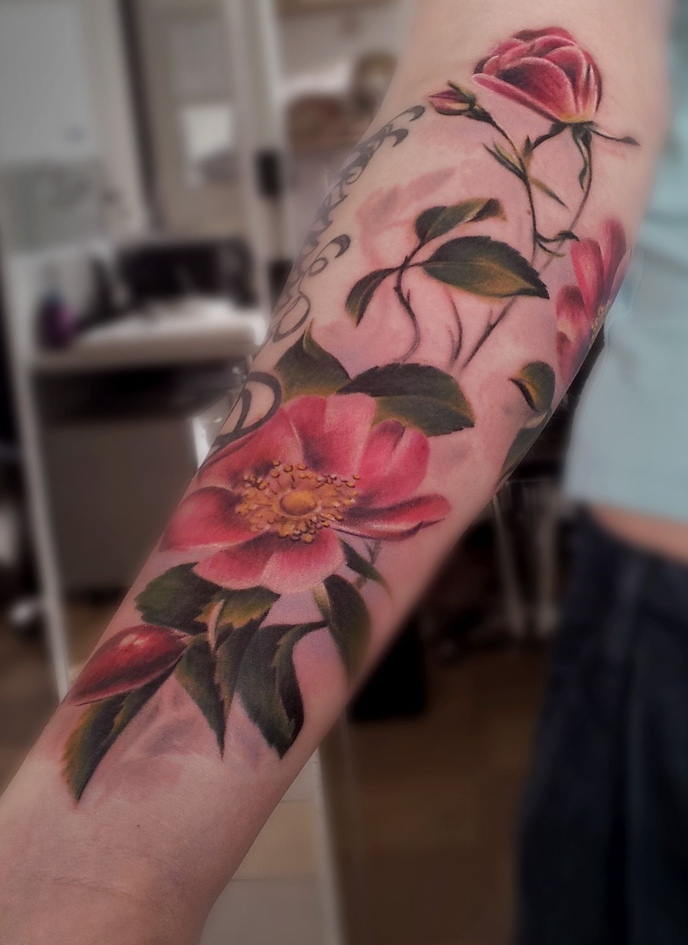 Colorful flower tattoo on womans lower arm. #rose #briar #flower ...