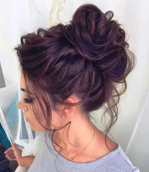 Curly Brown Hairs With Bun In Front For Girls Bun Hairstyles For Long Hair Casual Updos For Long Hair Long Hair Styles