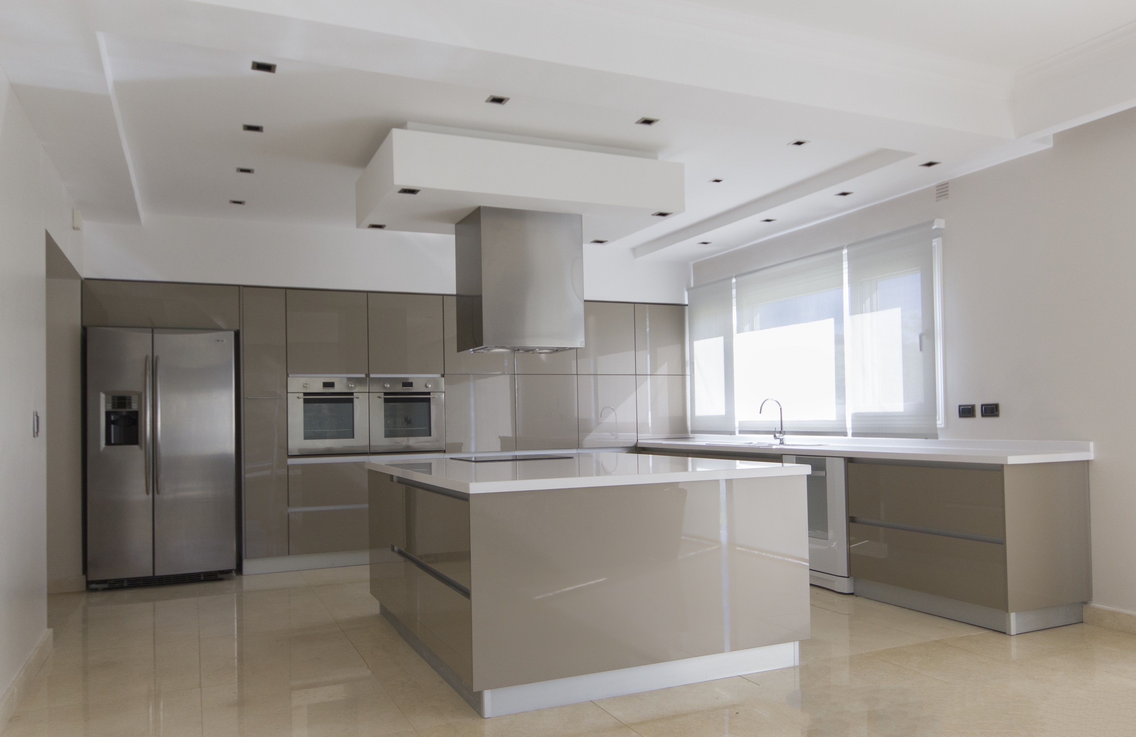 A minimalist kitchen creates an open and sleek environment. Design ...