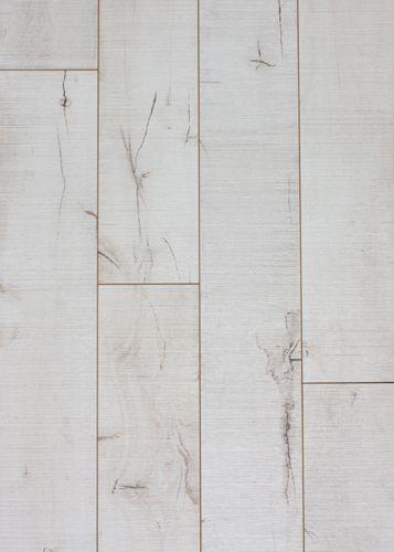 Laminate flooring designed to look like painted wood ...