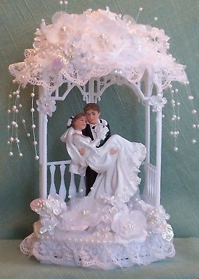 Groom Carrying Bride in Gazebo with Cascading Pearls Wedding Cake Topper