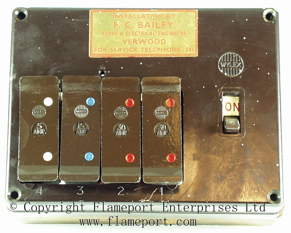 wylex standard 4 way fusebox with brown wooden frame old [ 1011 x 809 Pixel ]