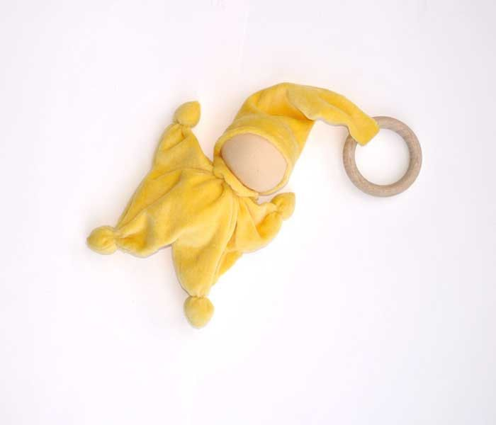 Teething waldorf doll for baby boy toy gnome from cotton terry,  spring Yellow.  wooden ring and bell in his hat. €20,00, via Etsy.