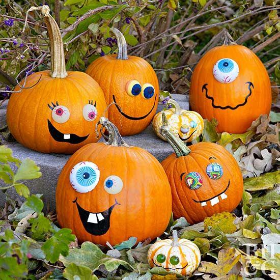 These Happy Jack O Lantern Faces Elicit Smiles Not Shrieks Pumpkin Decorating Pumpkin Carving Halloween Pumpkins