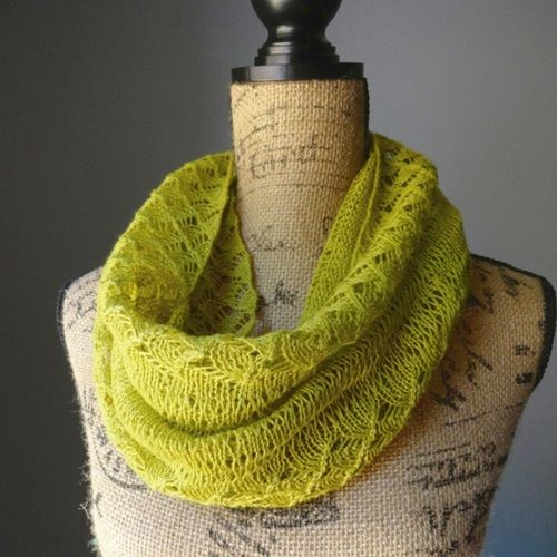 This chartreuse-colored infinity scarf pattern is pretty lace option for warm weather accessorizing. The Spring Lace Infinity Scarf features gorgeous lace edging and a simple body interspersed with few rows of dropped stitches for added interest.