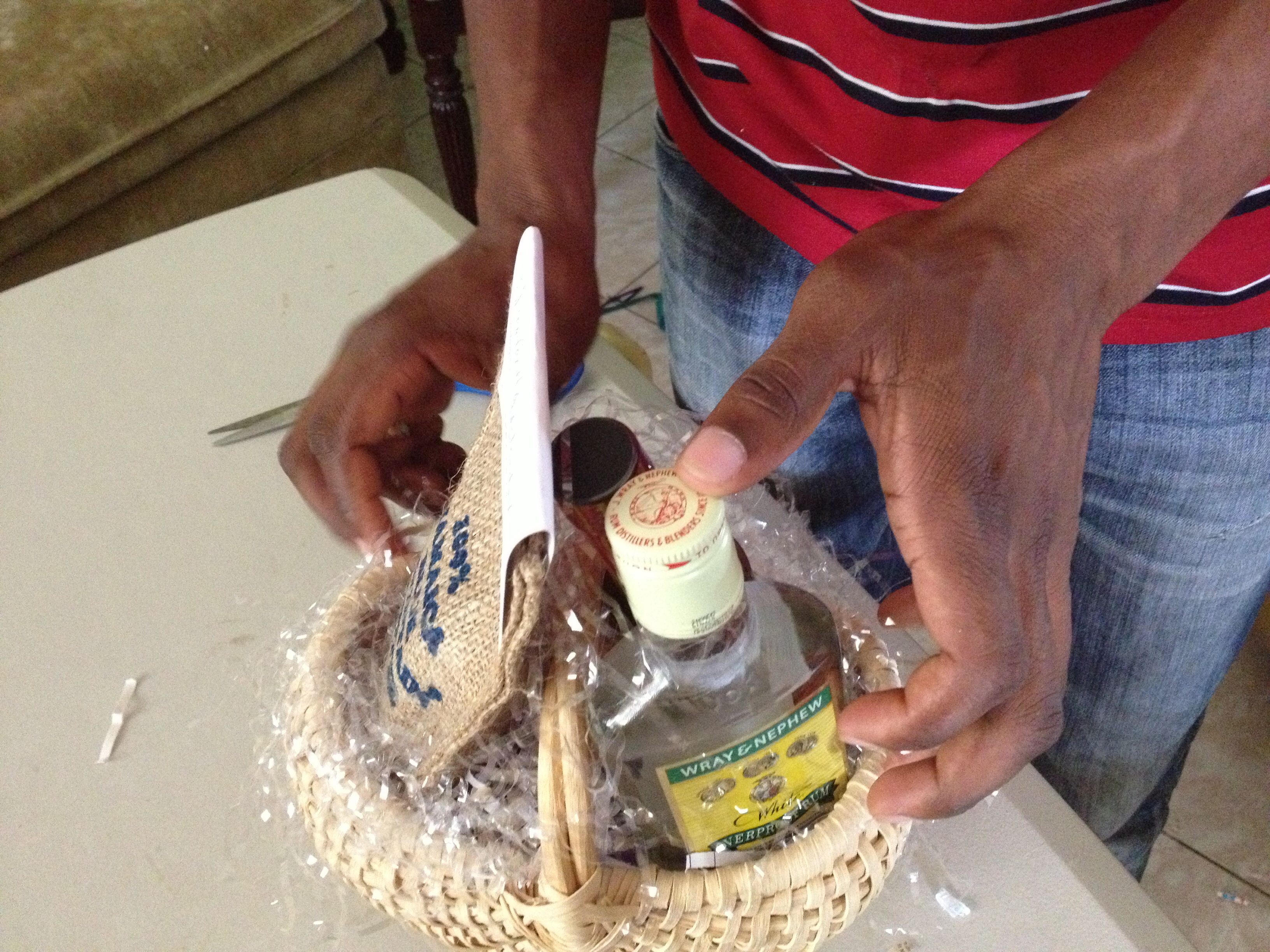 Preparing Wedding Favor Basket With Jamaican White Rum Jamaica Blue Mountain Coffee Jerk Sauce