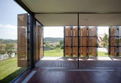 Casa moderna de un piso y tres dormitorios, fachada de madera con - fachada madera