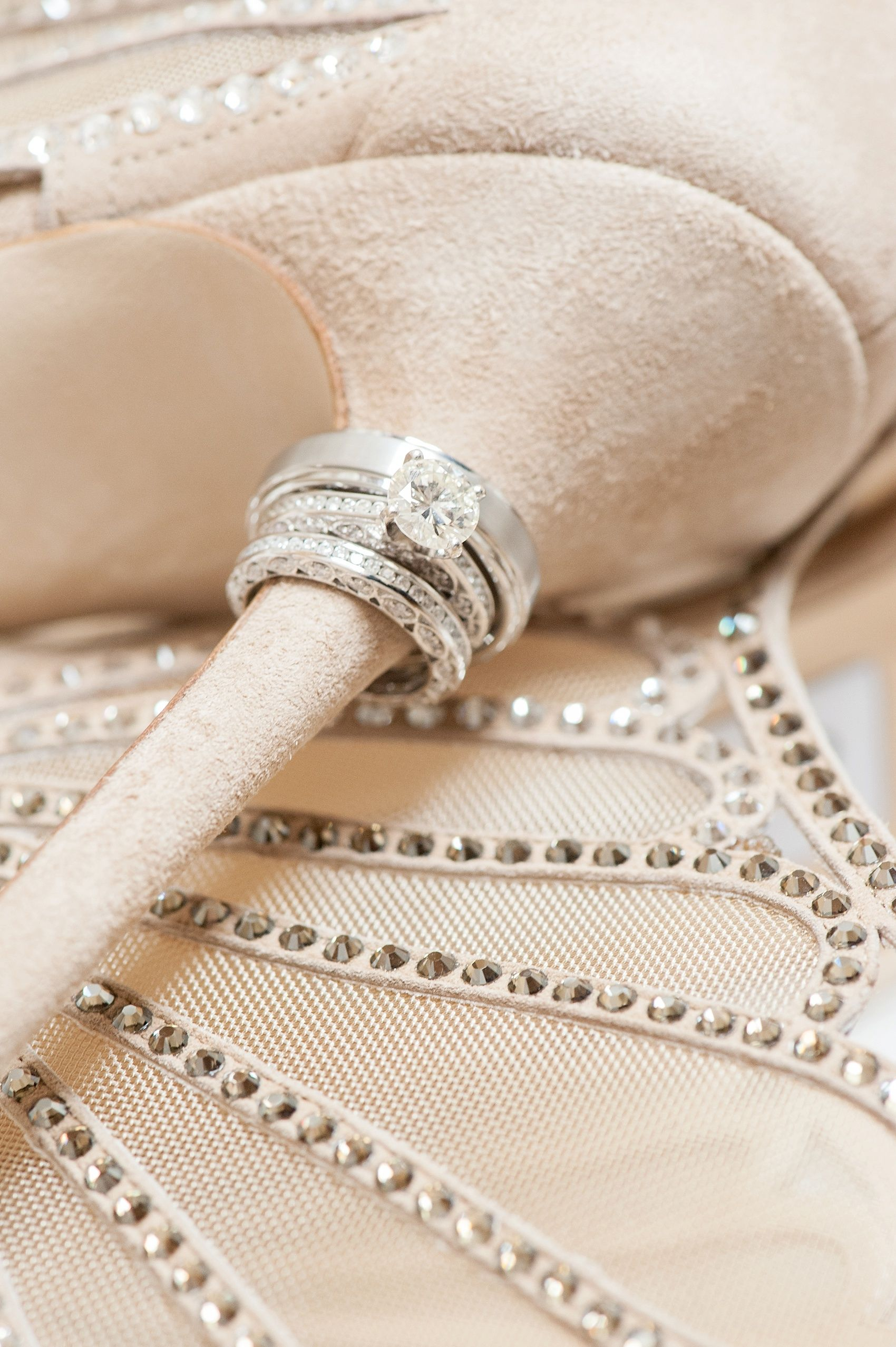 Detail ring shot on Jimmy Choo nude suede heels. Stonehouse at Stirling Ridge fall wedding. Photos by Mikkel Paige Photography, New Jersey wedding photographer. #mikkelpaigephotography #ringshots #jimmychoo #weddingshoes #weddingheels