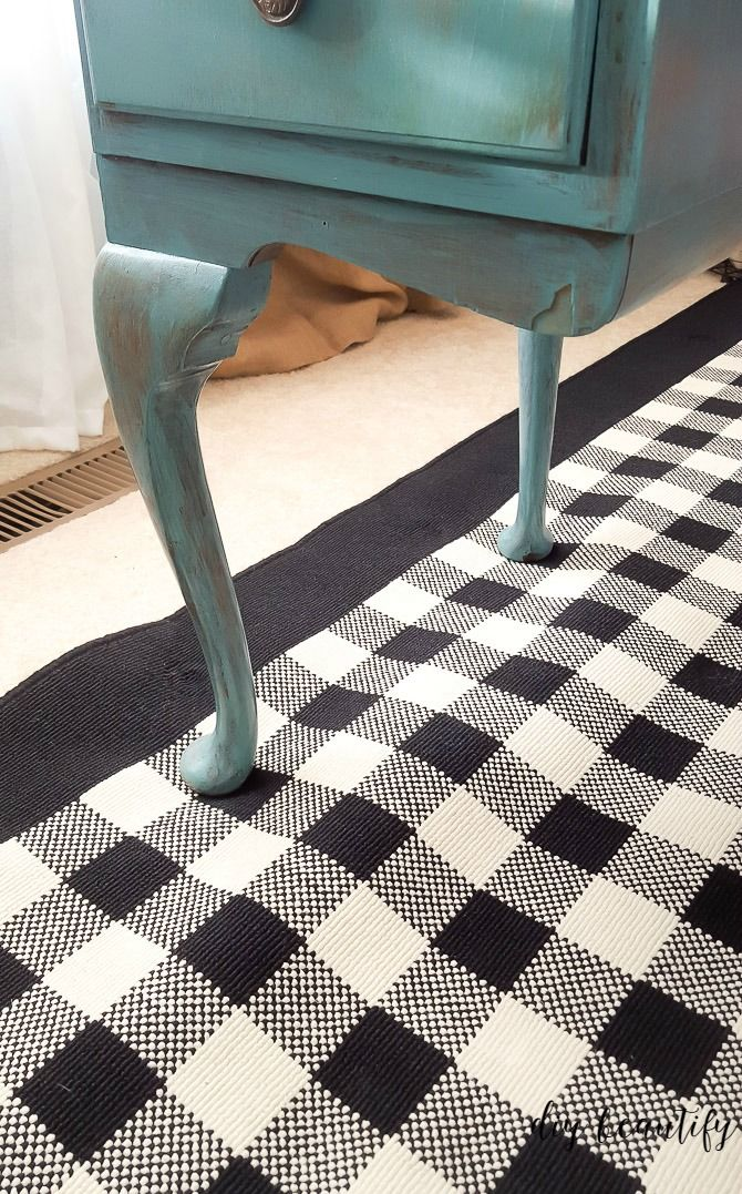 How To Keep Your Area Rugs From Buckling Rug Over Carpet Area Rugs Rugs On Carpet