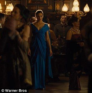 Warning Gal Wears A Blue Ball Gown With Her Sword Tucked In The Back At Sy Dinner
