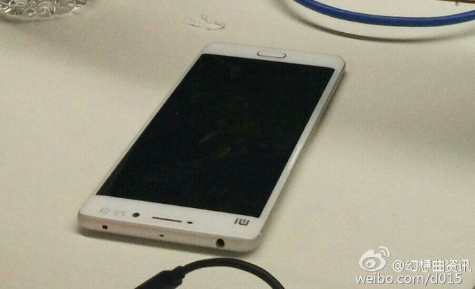 Alleged Xiaomi Mi 5 prototype gets caught on camera - http://vr-zone.com/articles/alleged-xiaomi-mi-5-prototype-gets-caught-camera/104782.html