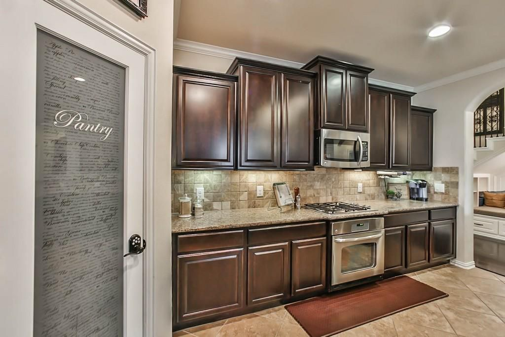 Traditional Kitchen With Inca Blend Travertine Tile