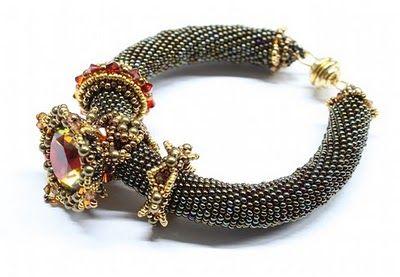 Sabine Lippert.  The interchangeable beaded rings slide on and off the bead crocheted bracelet.