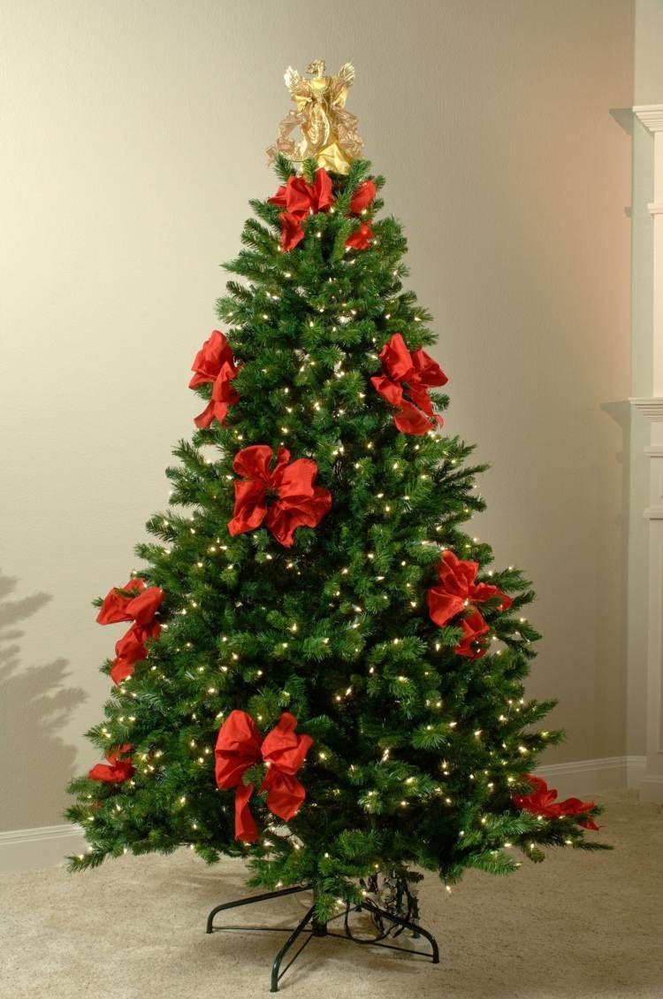 Schleifen Weihnachtsbaum.Schlichter Christbaum Schmuck Aus Lichterketten Und Großen Roten