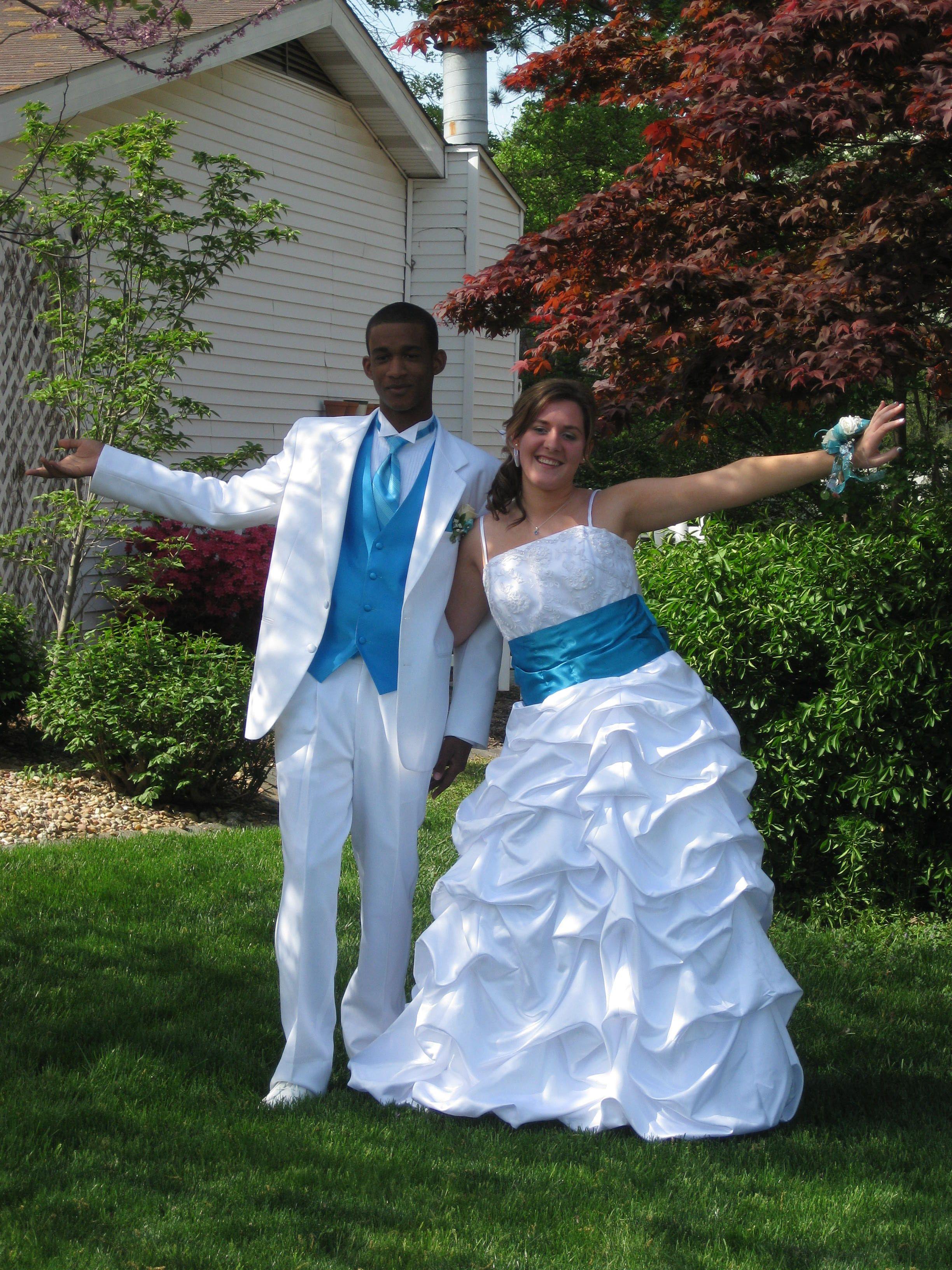 Inter-racial prom couple! wearing davids bridal wedding dress ...