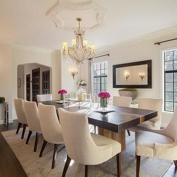 Black Dining Table With Cream Upholstered Dining Chairs Rug