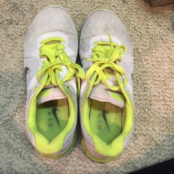 Nike Air Sneakers  Great condition, neon yellow and white, slighting staining on white mesh on toe but most likely can be washed out. Sliver logo on side Nike Shoes Sneakers