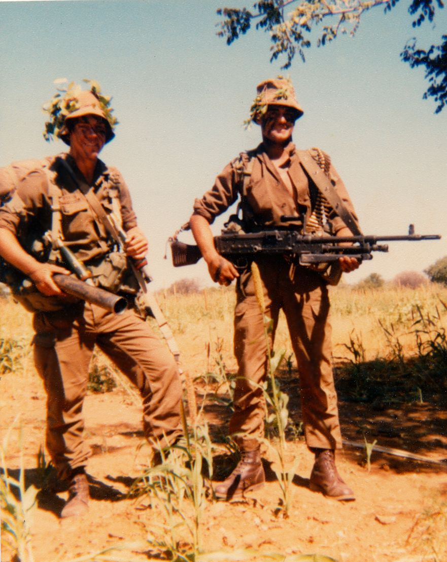 "Ian and Ricardo - Platoon 1, 3 SAI, somewhere across the 'kaplyn' May 1, 1980, Operation 'Liberation 1"". Note the 60mm and R1 rifle were carried. That's over 10kg plus four 60mm rounds at 1.4kg (total 5.6kgs) and four R1 mags took total to near 20kgs and that's not counting water or food. I was nearly always spared having a turn carrying the platoon B25 radio."