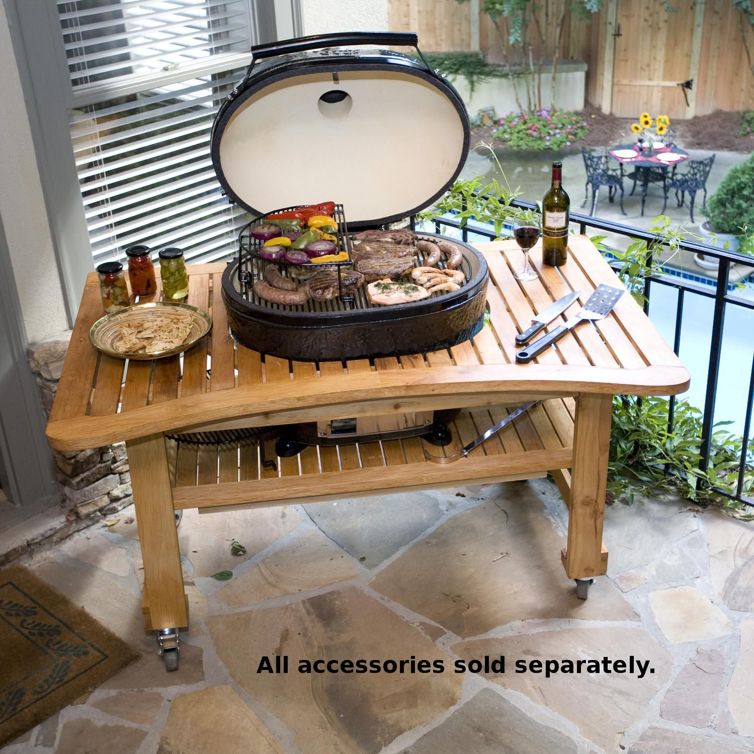 Charming Primo Oval XL Ceramic Kamado Grill On Curved Cypress Table