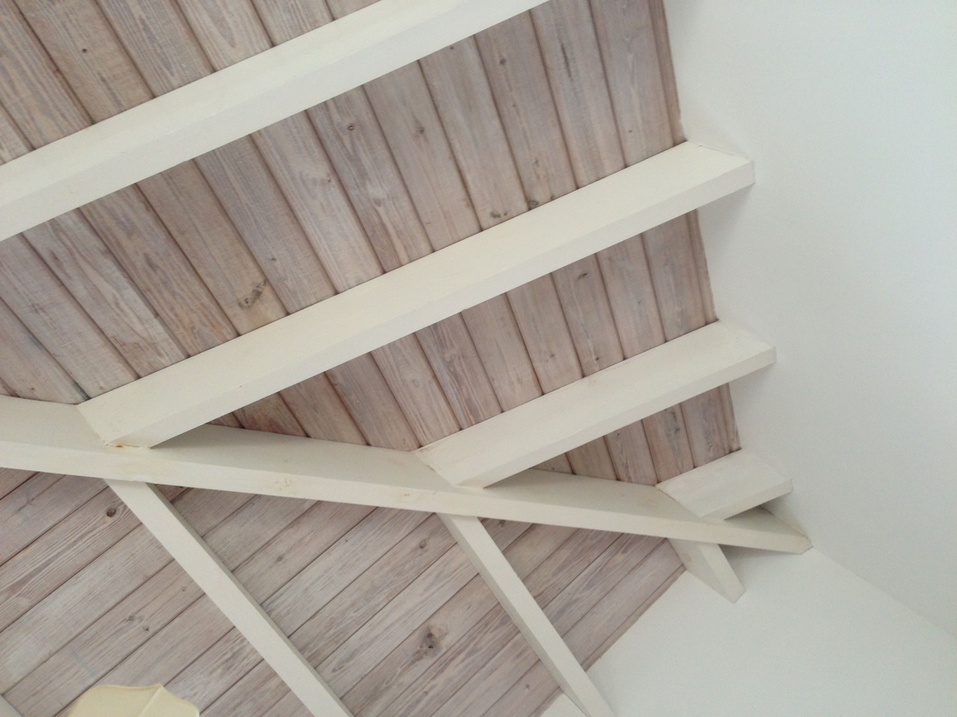 Cool whitewashed wood ceiling. Love.