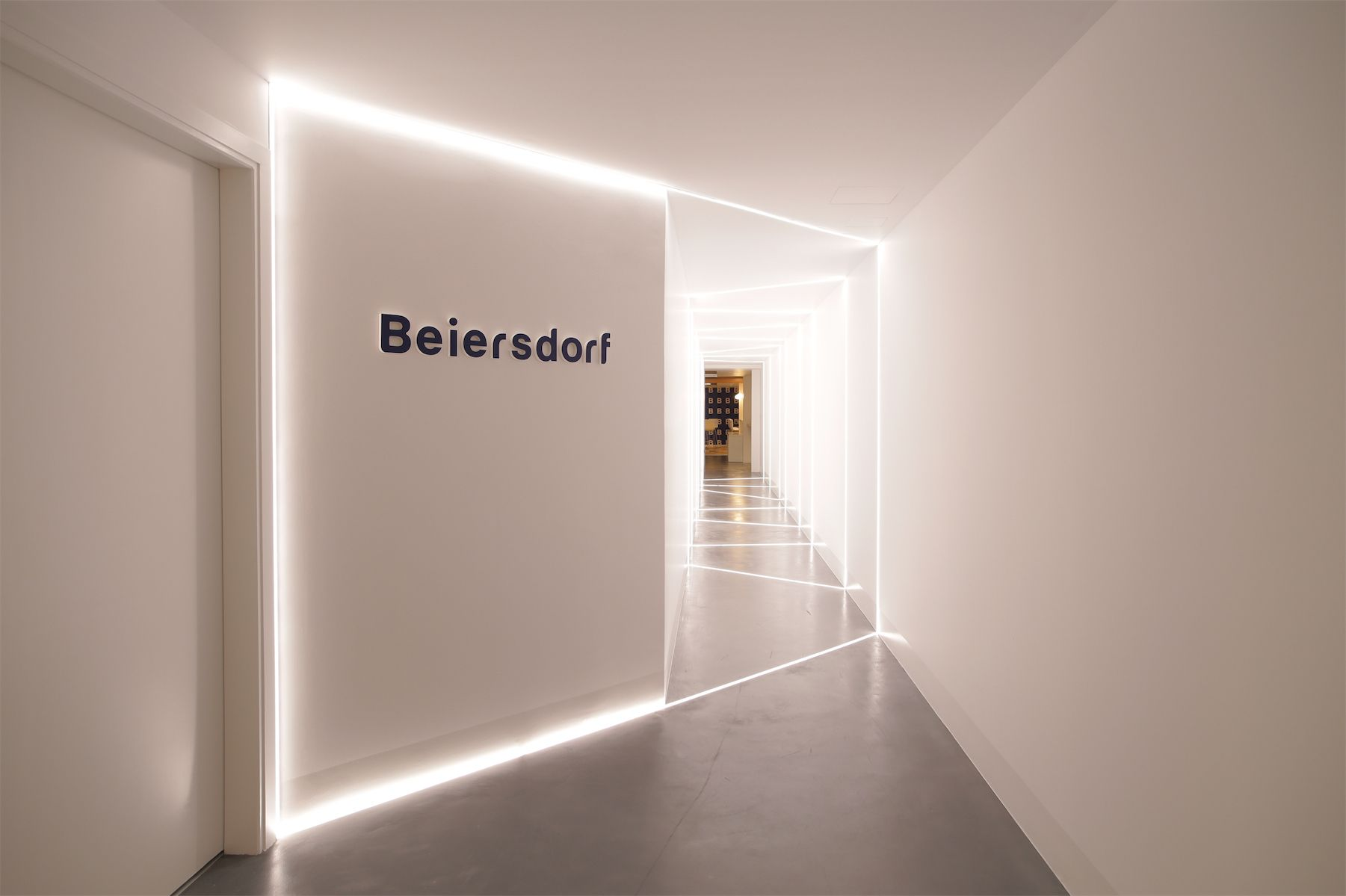 isle on the beiersdorf offices in athens greece with led stripes incorporated into the concrete - Incorporating Leds Into Interior Design