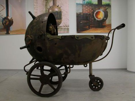 This Baby carriage consists of an entire mine-shell that has been placed on a chassis of an antique hand-stroller. Description from stealmag.com. I searched for this on bing.com/images