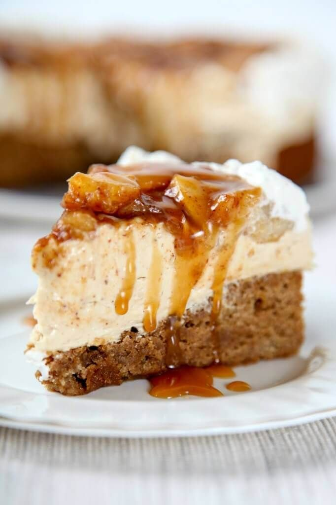 This Homemade Caramel Apple Cheesecake has a creamy cheesecake that's inside of a cinnamon blondie crust that's topped with cinnamon apples and caramel! via /bestblogrecipes/