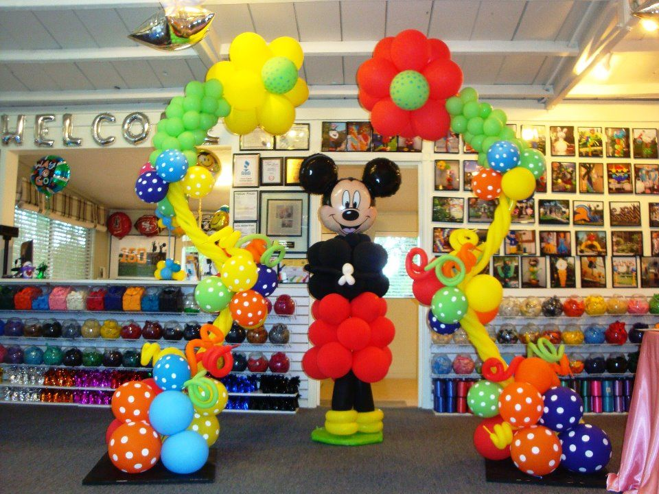 Awesome Mickey Mouse flower arch from Party Fiesta Balloon Decor in